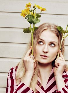 Actress Sophie Turner poses in a striped top