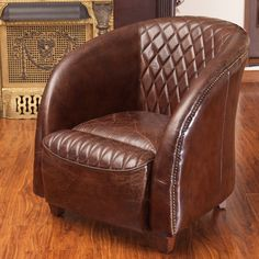 Rahim brown tufted leather club chair combines classic leather with accent finishing touches.