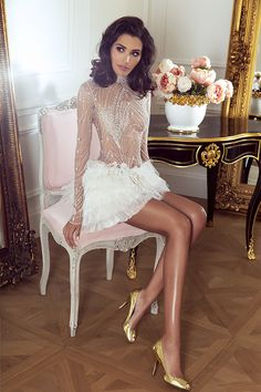 Sylwia Romaniuk Fashion Designer  Luxury white dress with Swarovski   crystals, model Sara Faraj
