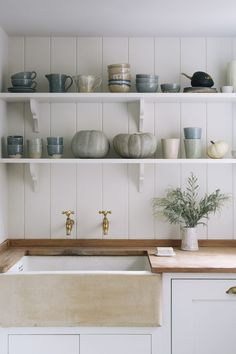 love this simple rustic kitchen sink with open shelves and rustic handade ceramic pottery and crockery by Aerende. Click through to discover more about this exciting new ethical homeware brand