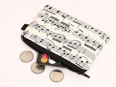 I got this a few weeks ago and I love it! Now I'm gonna put it in my music note phone purse! Coin purse small zip pouch small makeup bag padded by JadenDesign