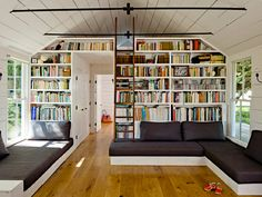 bench lounge seating, bookshelf, ladder loft, natural light