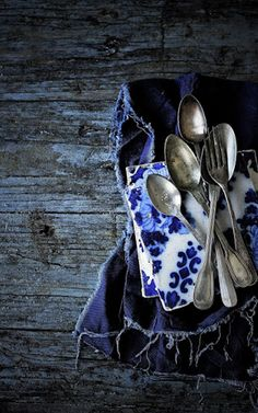Whimsical vintage home essentials -- Silver spoons, blue and white tiles, worn indigo napkins. Azul Indigo, Bleu Indigo, Mood Indigo, Love Blue, Blue And White, Van Kitchen, Photocollage, Still Life Photography, Food Photography