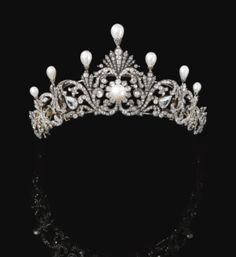 Natural pearl & diamond tiara, late 19th century.   Foliate scroll design, surmounted with 7 drop-shaped natural pearls each in a mount embellished w/rose diamonds, graduated in size from the centre, the scroll surrounds set with pear cushion-shaped & circular-cut diamonds, the button-shaped pearl at the centre of a cluster motif, inner circumference approx 380mm, may be detached into 8 jewels, 3 may be worn as brooches, the 2 larger pear shaped diamonds are later additions, w/a fitted case.
