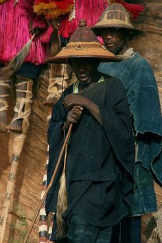 Africa |  Dogon Elders wearing hats normally associated with the Fulani people. Dogon Country, Mali | © Mark Abel