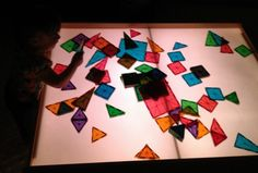 Train table to light table. Great idea for a sensory room! Love those magnets; wish they weren't so expensive.
