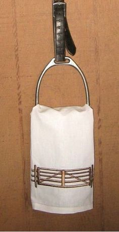 Stirrup and stirrup leathers towel holder. Love the look but don't even want to think about how filthy my stirrups are.