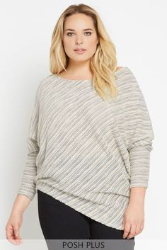 A cozy, cotton-blend pullover in a two-tone striped pattern is accented with an asymmetrical hemline and dolman sleeves. Perfect piece to embrace the cold weather in style. This top is unlined.