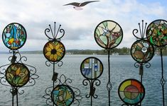 These stained glass sun catchers would look amazing in my garden!