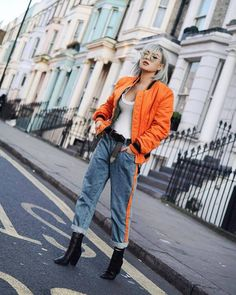 $100 - $1000 On Trend Bright Neon Orange Long Sleeved Bomber Jacket With Matching Light Blue Denim Jeans And Bright Orange Stripe Detail Perfect For Spring Summer Fashion Week Street Style Orange Outfits, Vogue Fashion, 80s Fashion, Korean Fashion, Korean Street Fashion Urban Chic, Mode Outfits, Stylish Outfits, Orange Bomber Jacket, Vintage Outfits