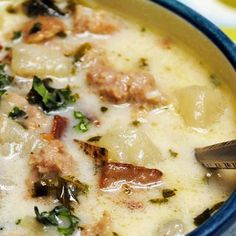 Olive Garden: Zuppa Toscano Potato Sausage Soup - 1	pound spicy Italian sausage ½	pound bacon, chopped 6	cups chicken stock 3	large russet potatoes, scrubbed clean and cubed 2	cloves garlic, chopped 1	medium onion, chopped 2	cups chopped kale 1	cup heavy whipping cream salt and pepper, to taste