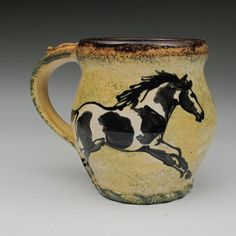 Stoneware mug with paint horses from Morris Pottery.