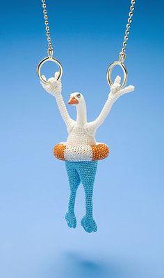 Felieke van der Leest Necklace: Gusz Goosz 2006 14kt gold, textile, glass, plastic animal, topaz hanging goose 12.5 x 4.5 x 4.5 cm