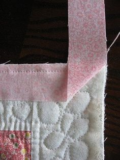 Binding with Mitered Corners https://wendysknitch.wordpress.com/2008/02/09/tutorial-quilt-binding-with-mitered-corners/