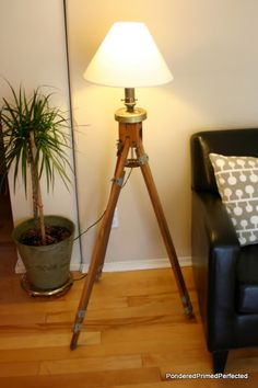 Pondered.Primed.Perfected ~  DIY lamp made from old, wooden, tripod easel with extendable legs for a whopping $3.99 at our local GW store + $2.99 shade, + approximately $3.00 in miscellaneous hardware and a $1 junk lamp. Total cost --- less than $10 for a knockoff version of the Tripod Lamp from Restoration Hardware & Pottery Barn.