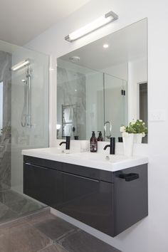 Dark tapware complement the cabinets and tiles