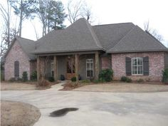Circle drive, side-entry garage (hopefully, divided 2-car), brick, ranch-style...kinda cute!