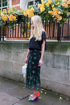 - A gauzy floral midi skirt pairs well with bright shoes and a sleek white box bag.