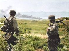 the_ww2_memoirs Two Fallschirmjäger of 1st/3rd Battaltion, 3rd Fallschirmjäger Regiment, look at smoke rising in the distance on top of a hill overlooking Maleme Airfield, Crete, May 1941. In early 1941 the Germans invaded Yugoslavia and Crete after the Italians were dialing miserably, and the British were landing their forces in Greece which could threaten their flank during Barbarossa. The invasion of Yugoslavia began in April 1941, although the Yugoslavian military put up their best fight…