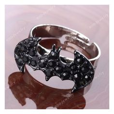 1x Black Crystal Rhinestone Batman Fashion Women's Finger Ring... ❤ liked on Polyvore featuring jewelry, rings, accessories, batman, crystal stone jewelry, crystal stone rings, crystal jewellery, crystal rhinestone jewelry and rhinestone rings