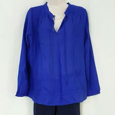 """Small Lucky Brand Rouleau Button Peasant Blouse New, never worn or washed   Color: Surf the Web blue  Material: 100% viscose  Pit to pit: 22""""  Top to bottom: 26""""  Pointelle stitch detailing, skinny ties at split neckline, sheer fabric base layer recommended underneath, rouleau button long sleeves Lucky Brand Tops Blouses"""