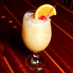 <3 2 ozRum, 4 oz Pineapple juice, 1 oz Orange juice, 1 oz Cream of coconut.Garnish: Orange wedge, cherry and nutmeg. Preparation:Add all the ingredients to a Hurricane glass and fill with ice. Stir to combine and garnish with an orange wedge, a cherry and freshly grated nutmeg