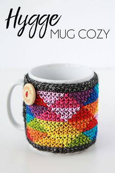 https://haakmaarraak.nl/free-crochet-pattern-hygge-mug-cozy/; The Hygge mug cozy is perfect for small scraps and leftovers!