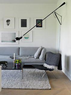 Esprit gris à Malmö. Sin duda tiene un aire masculino, pero podría vivir en este departamento sueco.