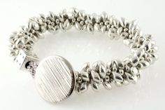Silver Bracelet, Beaded Bracelet, High Roller Braided Kumihimo Bracelet with Magatama beads and button closure by CAAZandeffect on Etsy, $38.00