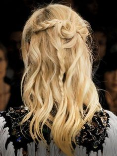 At the fall 2013 Rodarte show, hairstylist Odile Gilbert made boho waves even better by adding a twist, two braids, and heaps of texture. Here's how to get the hairstyle at home. | allure.com