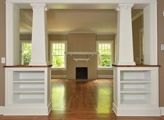 """Built-In Room Divider: """"Interior tapered columns with dentil detailing top 30-inch bookcase cabinets."""""""