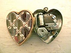 vintage music box locket, not a fan of the cover, but still cool