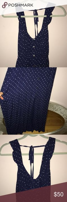 Billabong Blue and White Polka Dot Maxi Dress Cutest Dress! I purchased it and took the tags off to wear in my engagement photos, but never ended up wearing it! It buttons up in the front and is open in the front at the bottom. Ties is the back and has a keyhole opening! It's so flattering and I wish I had a reason to wear it! Billabong Dresses Maxi