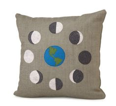 For the nights when your favorite decorator sits on her furnished porch and marvels at the natural sparkle surrounding her home. |  Moon Phase Pillow | UncommonGoods