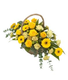 Pure Gold: Classic basket arrangement in bright golds: golden Roses and Gerbera fight to outshine the rest of the bunch. Perfect for a Golden wedding anniversary gift.