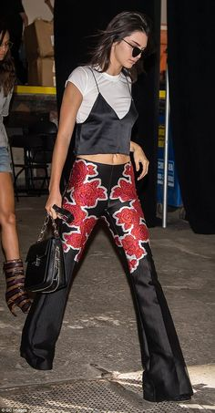Making a flower power statement: Jenner had on black and red floral slacks that made her legs look six feet long and lean