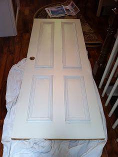 Urban Squirrel: DIY Door Makeover. She took a flat door and added trim to make it look paneled. Brilliant! My front door needs this!