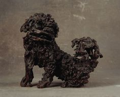 Finch & Co - An Unsual and impressive pair of Chinese Rootwood Dogs of Fo or Lion dogs 'Shih Tzu Kou' 18th century