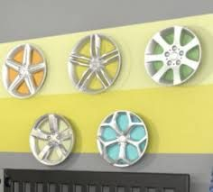 above laundry shelving: hubcap wall decor
