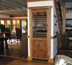 Wine closet.  Fits under the stairs.