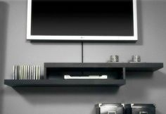 Sign up to see the rest of what's here!                 all white floating tv wall mount  shelvesSmall Shelves Under Wall-Mounted TVPorrowall mounted tv console | Wall mounted TV with console table underneath: I really like how they ...Rustic console table for under wall mounted TV. The DVD