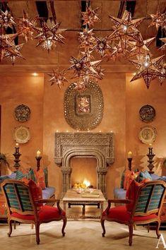 Eclectic Living Room with Cement fireplace, Daltile Catalina Canyon Noce 12x12 Porcelain Floor and Wall Tile, Pendant light
