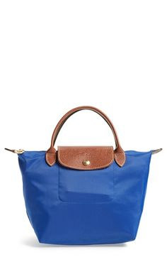 Free shipping and returns on Longchamp 'Mini Le Pliage' Handbag at Nordstrom.com. Lightly textured leather borders a durable, water-resistant nylon tote that folds into a small rectangle when not in use, making it perfect for travel.