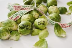 "'cuz nothin' says ""Happy Holidays"" like someone writing messages on brussels sprouts in time for Christmas. Eat, stink & be merry!"