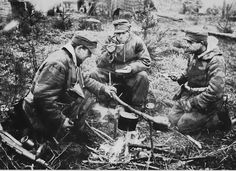 Three German infantrymen prepare a quick hot meal somewhere in the forest of central Europe as they inexorably retreat toward the old German frontier. They are still relatively well kitted but their expressions reveal their true sentiment, Feb 1944.