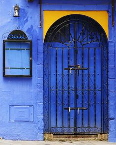 I love the blue door. I'm not sure where I would put it in my house, but it's certainly beautiful!