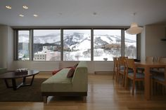 Yama Shizen Penthouse with a splendid view over Grand Hirafu Ski Resort. Views are especially beautiful during winter evenings when night skiing is available.  http://htholidays.com/niseko-accommodation/luxury/yamashizen