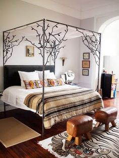 The Diego Canopy Bed @ Casamidy is like sleeping under a tree canopy. <3 the free flowing inrticate wrought ironwork that mimics sprouting tree branches.