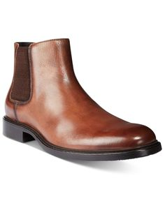 Super luxe style arrives in the form of the Grand Scale Chelsea boots from Kenneth Cole New York. | Leather upper; rubber sole | Imported | Plain toe  | Slip-on style  | Leather lining for comfort and