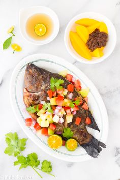 Filipino grilled tilapia recipe with mango, tomato, and cilantro medley. Note to self: make Filipino friends.